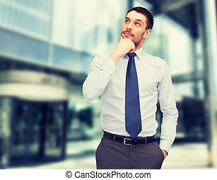 handsome businessman looking up - business and office...