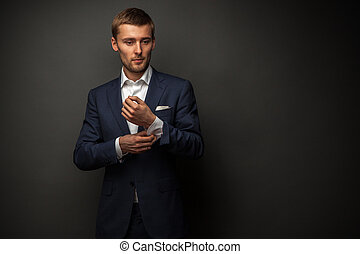 handsome businessman on black