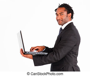 Handsome businessman on laptop