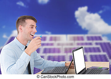 Handsome businessman on meeting with blurry background of...