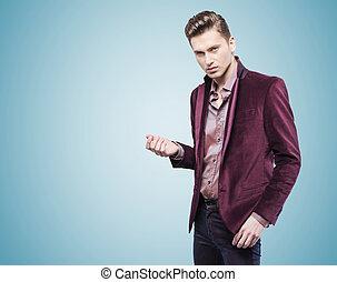 Handsome businessman over the blue background