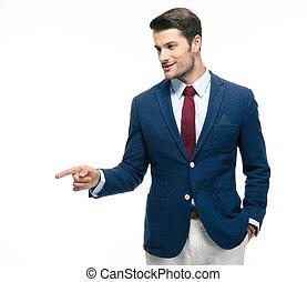 Handsome businessman pointing finger away