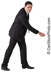 Handsome businessman pulling with hand