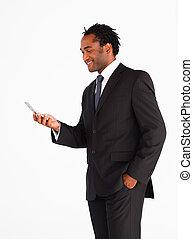 Handsome businessman sending text message