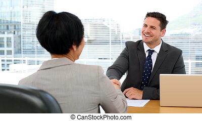Handsome businessman shaking hands