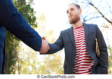 Handsome Businessman Shaking Hands with Partner
