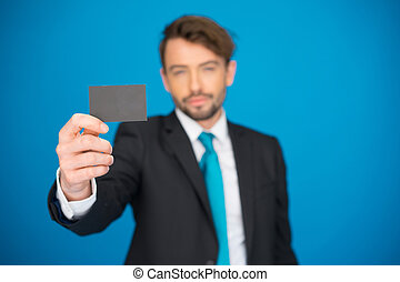 handsome businessman showing blank business card