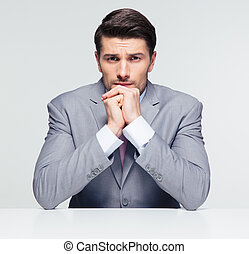 Handsome businessman sitting at the table