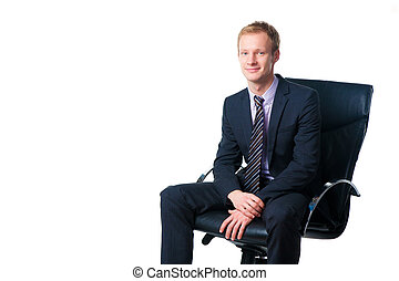 handsome businessman sitting in office chair