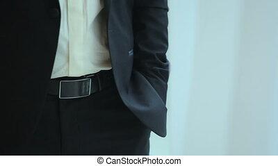 Handsome businessman talking at phone