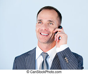 Handsome businessman talking to the phone