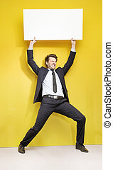 Handsome businessman trying to lift up the board