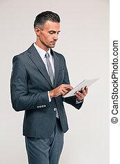 Handsome businessman using tablet computer