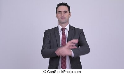 Handsome businessman with arms crossed against white background