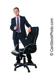 handsome businessman with black office chair