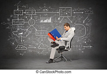 handsome businessman with folders sitting on chair