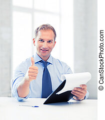 businessman with papers showing thumbs up