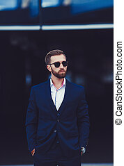 Handsome businessman with sunglasses