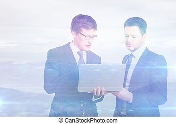 Handsome businessmen using laptop