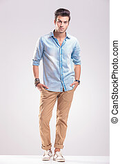 Handsome casual young man standing