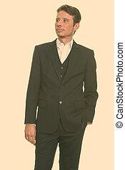 Handsome Caucasian businessman thinking