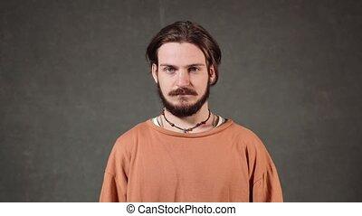 Handsome Caucasian Man Smiling - Dark-haired caucasian man...