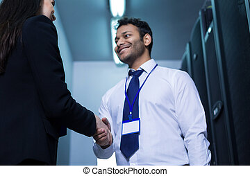 Handsome cheerful man greeting his new colleague
