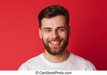 Handsome cheerful young man looking camera.