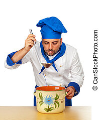Handsome chef with pot isolated