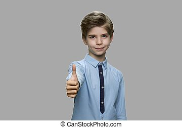 Handsome child showing thumb up sign.
