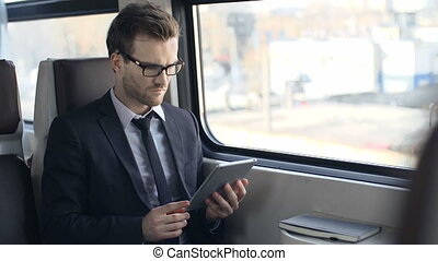 Handsome Commuter - Close up of handsome businessman using...