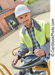 handsome construction worker on a building industry construction site