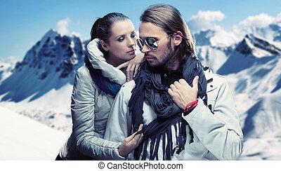 Handsome couple having fun on winter holidays