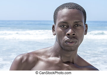 Handsome dark summer beach stud
