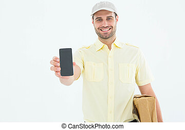 Handsome delivery man showing mobile phone