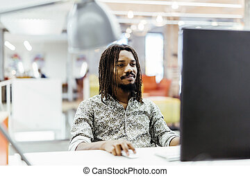 Handsome designer working in an office