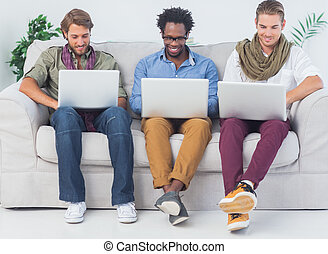 Handsome designers working with laptops