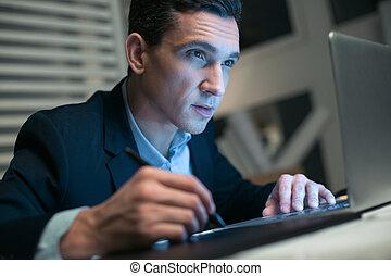 Handsome earnest businessman concentrating on work
