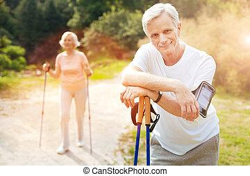 Handsome elderly man having a break