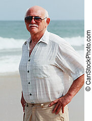 handsome elderly man on the beach