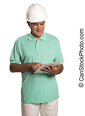 Handsome engineer holding tablet, isolated on white