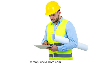 Handsome engineer working with a tablet pc, isolated on white