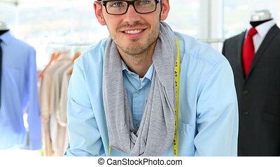 Handsome fashion designer smiling
