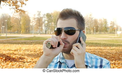 Handsome fashionable caucasian man talking on the phone and...
