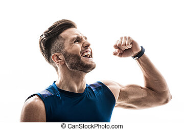Handsome fit athlete is happy for his victory