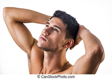 Handsome, fit shirtless young man isolated