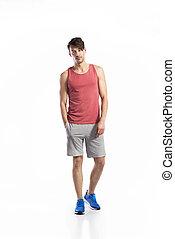 Handsome fitness man in red tank top, studio shot. -...