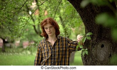Handsome ginger guy standing at the spring park. - Nice...