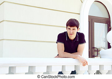 Handsome Goodlooking man on exterior architecture, outdoors portrait