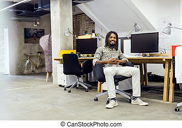 Handsome graphics designer sitting at a desk